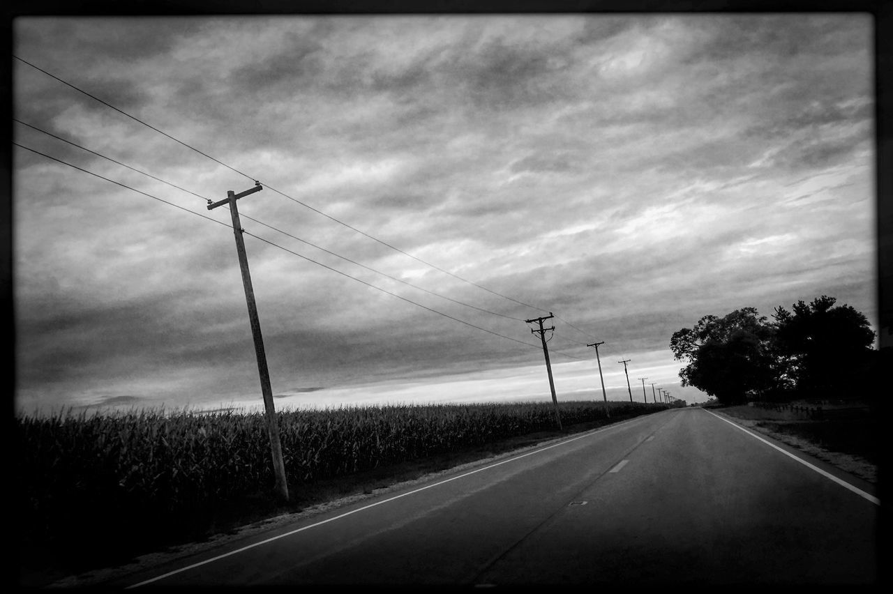 Seneca Road in Grundy County, Illinois. Road Transportation The Way Forward Sky Long Tree Road Marking Auto Post Production Filter Diminishing Perspective Power Line  Cloud - Sky Cloud Pole Day Vanishing Point Cable Tranquility Tranquil Scene Outdoors Empty Road Photojournalism EyeEm Best Shots Hipstamatic