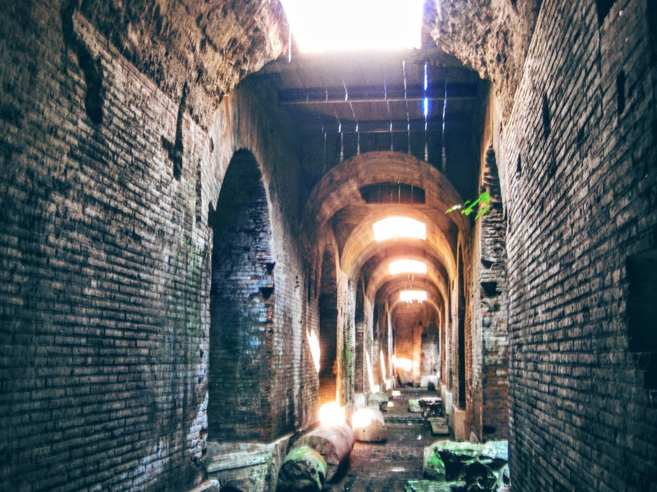 illuminated, brick wall, architecture, lighting equipment, built structure, night, indoors, tunnel, no people, building exterior