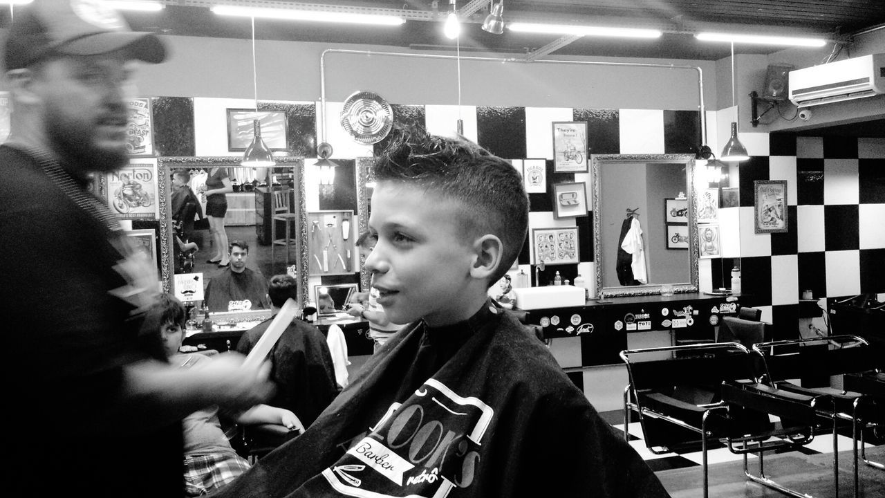 Only Men Small Business Indoors  Barber People Arts Culture And Entertainment Child Blac&white  Black And White Collection  Blackandwhite Hair Style Sitting Haircut Indoors  Two People Males