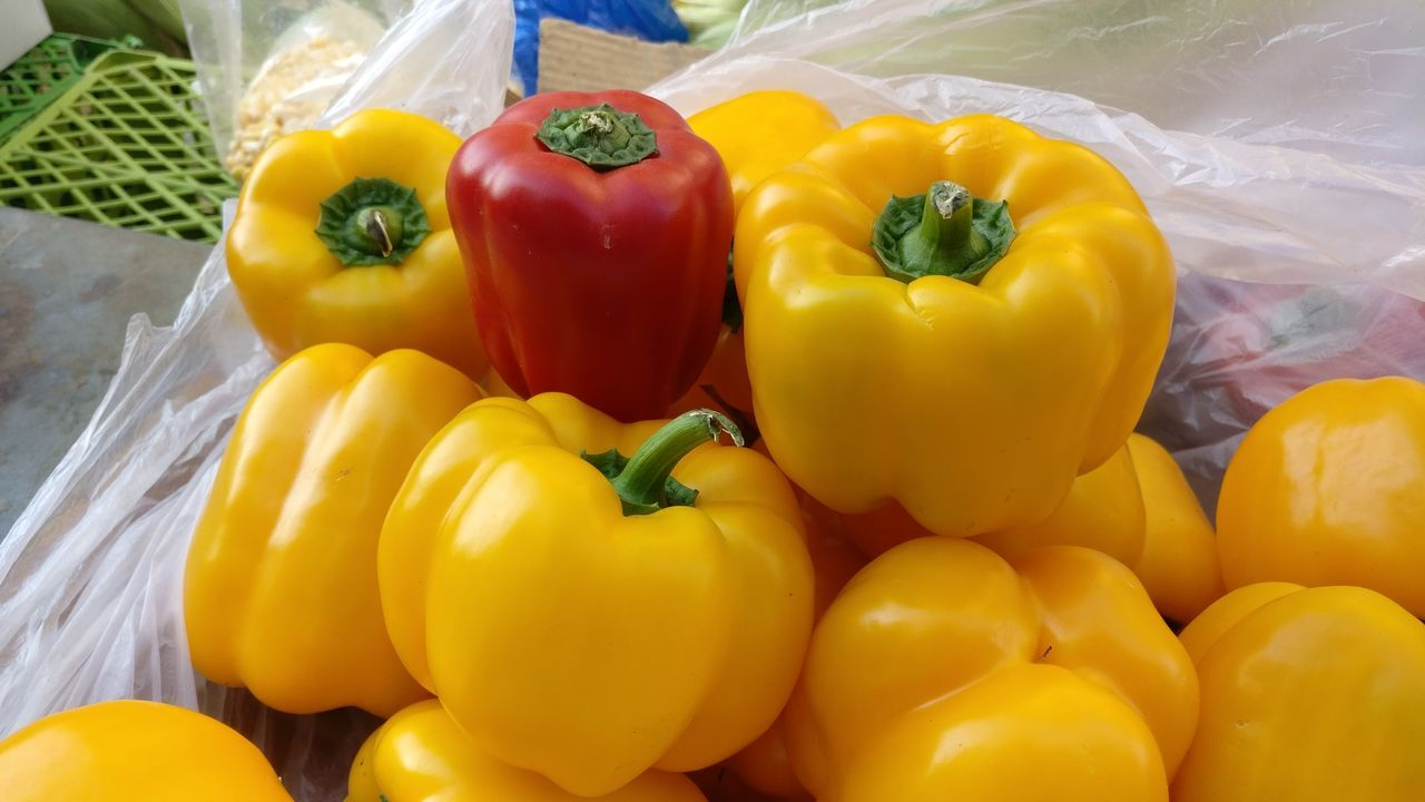Capsicum Vegetable Healthy Eating Yellow Bell Pepper Red Bell Pepper Variation Freshness Food Food And Drink Close-up Market Choice Multi Colored No People Supermarket Outdoors Day