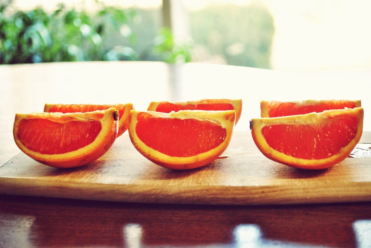 slice, freshness, healthy eating, fruit, citrus fruit, cross section, still life, table, indoors, food, food and drink, halved, no people, blood orange, close-up, day