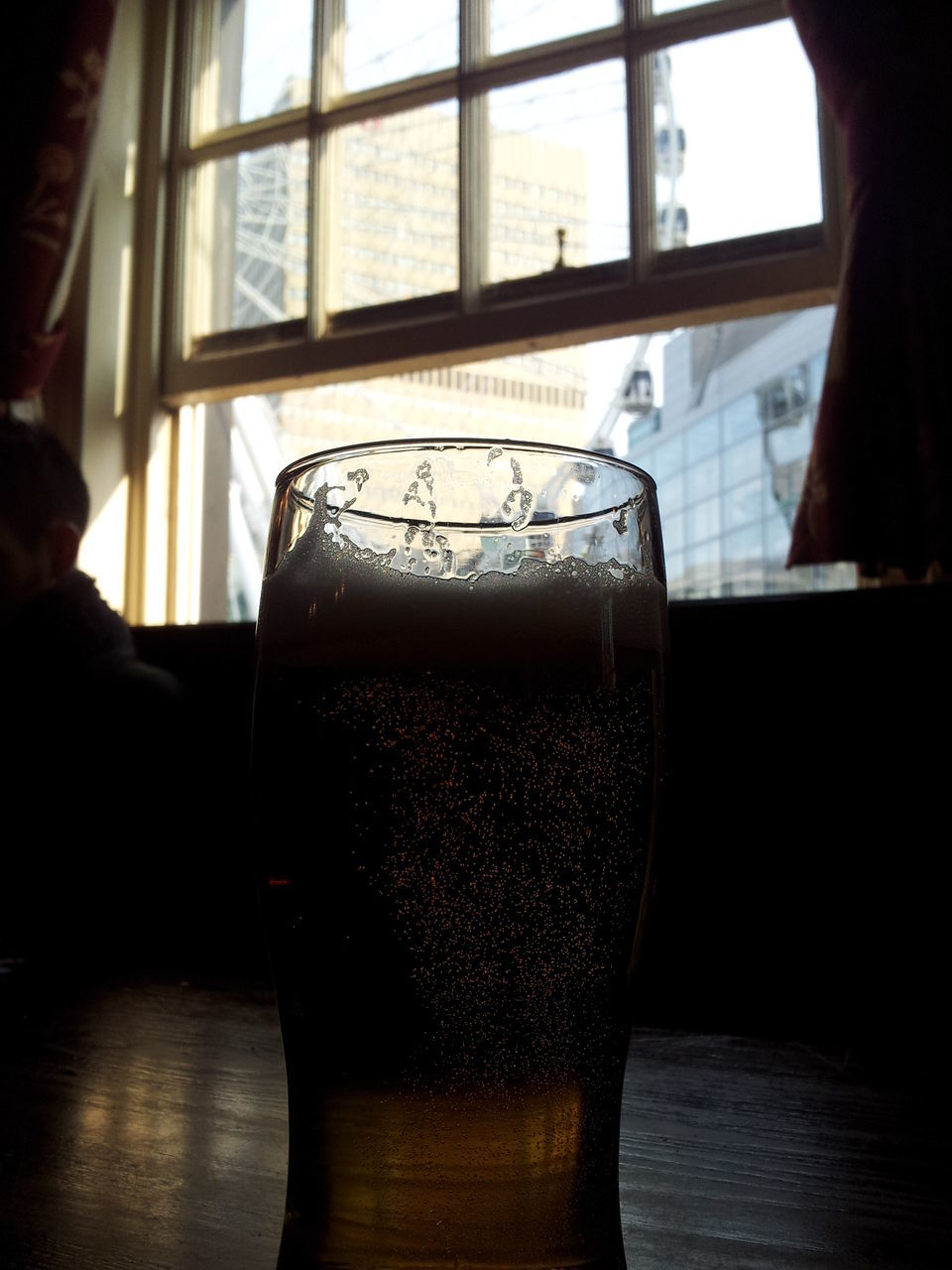 drink, alcohol, refreshment, beer glass, indoors, food and drink, drinking glass, table, beer - alcohol, frothy drink, beer, freshness, real people, close-up, day