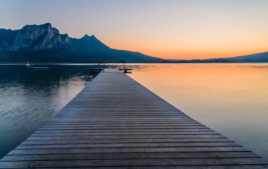 EyeEm Selects Tranquil Scene Mountain Scenics Pier Beauty In Nature Nature Sunset Jetty Water Tranquility Idyllic Sky Lake Landscape Outdoors Reflection No People Clear Sky Travel Destinations Day
