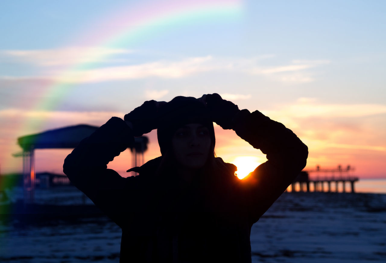 Adult Adults Only Beach Day Girl Human Body Part One Man Only One Person Only Men Outdoors People Rainbow Sea Skull Sky Sky And Clouds Snow Snowy Snowy Days... Standing Sunset Sunset_collection Water Young Adult