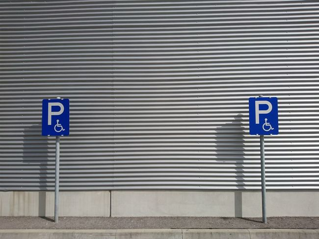 Arrow Symbol Blue Closed Communication Corrugated Iron Day Guidance Handicapped Handicapped Sign Handicapped Symbol Information Sign Metal No Parking Sign No Smoking Sign Outdoors Parking Sign Road Sign Safety Sign Symbol Text Warning Sign Western Script TakeoverContrast