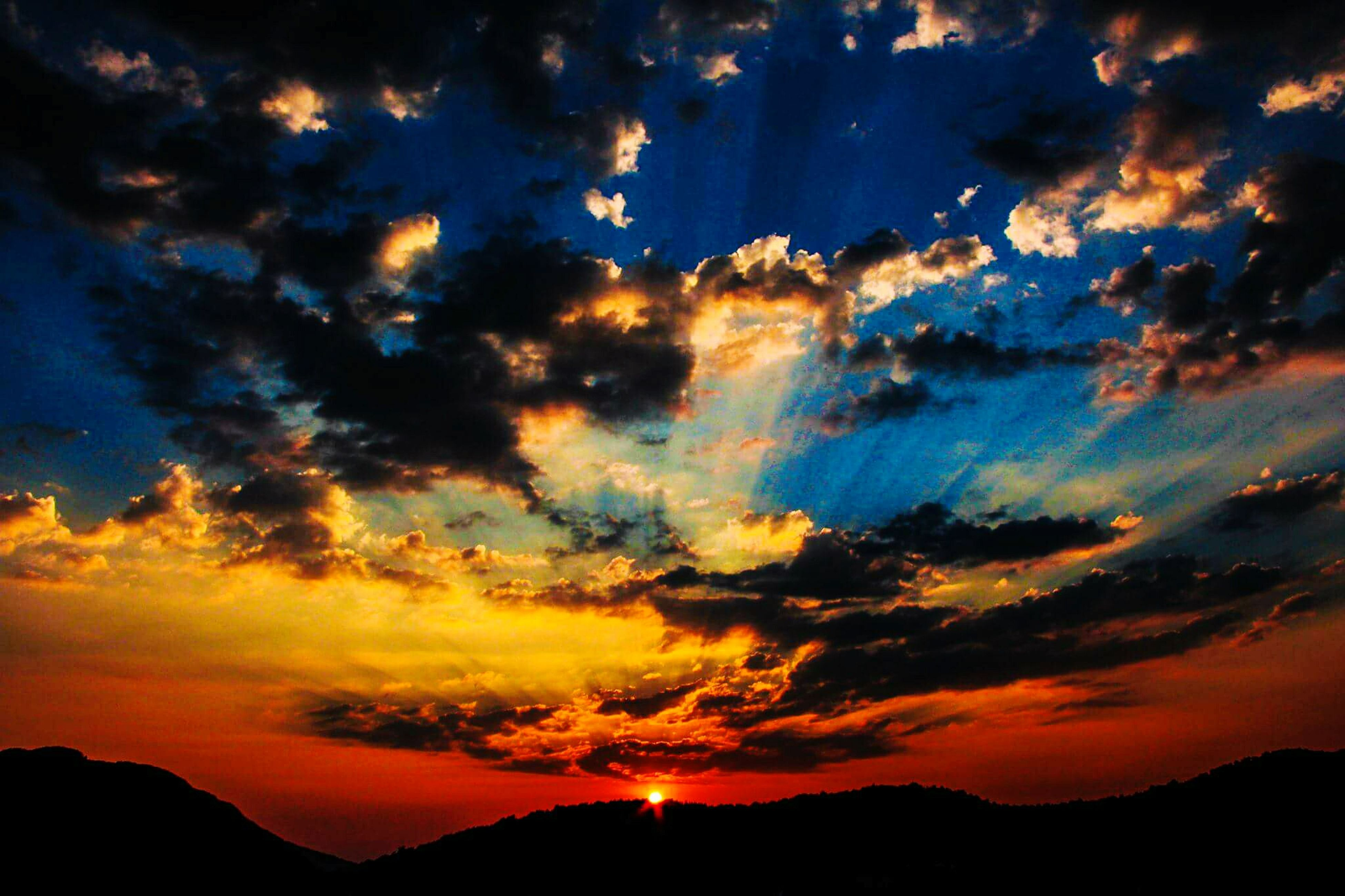 sunset, scenics, sky, silhouette, beauty in nature, tranquil scene, tranquility, cloud - sky, dramatic sky, orange color, idyllic, nature, mountain, majestic, cloud, landscape, cloudy, atmospheric mood, moody sky, awe