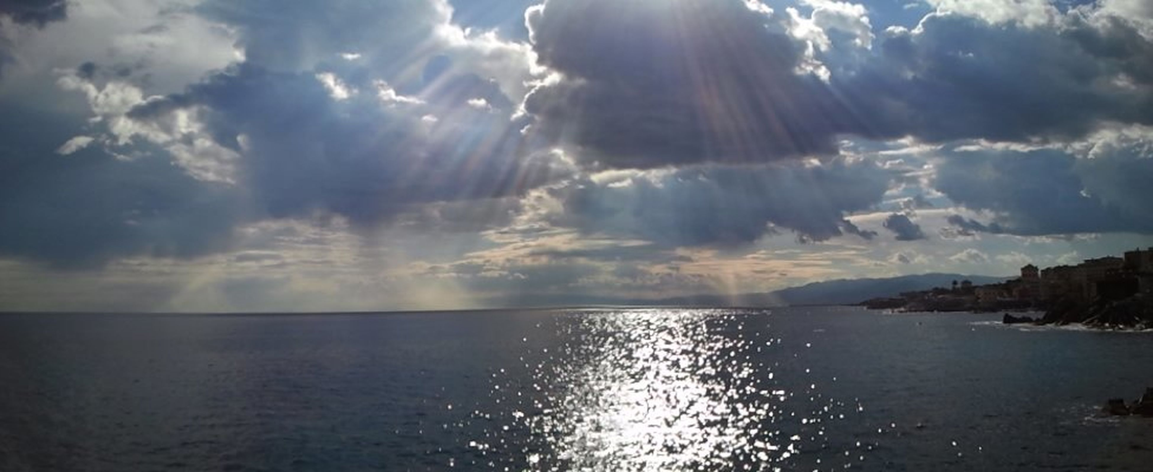 water, sea, sky, scenics, tranquil scene, tranquility, beauty in nature, horizon over water, cloud - sky, waterfront, nature, cloud, reflection, cloudy, idyllic, sunlight, sunset, seascape, sunbeam, outdoors