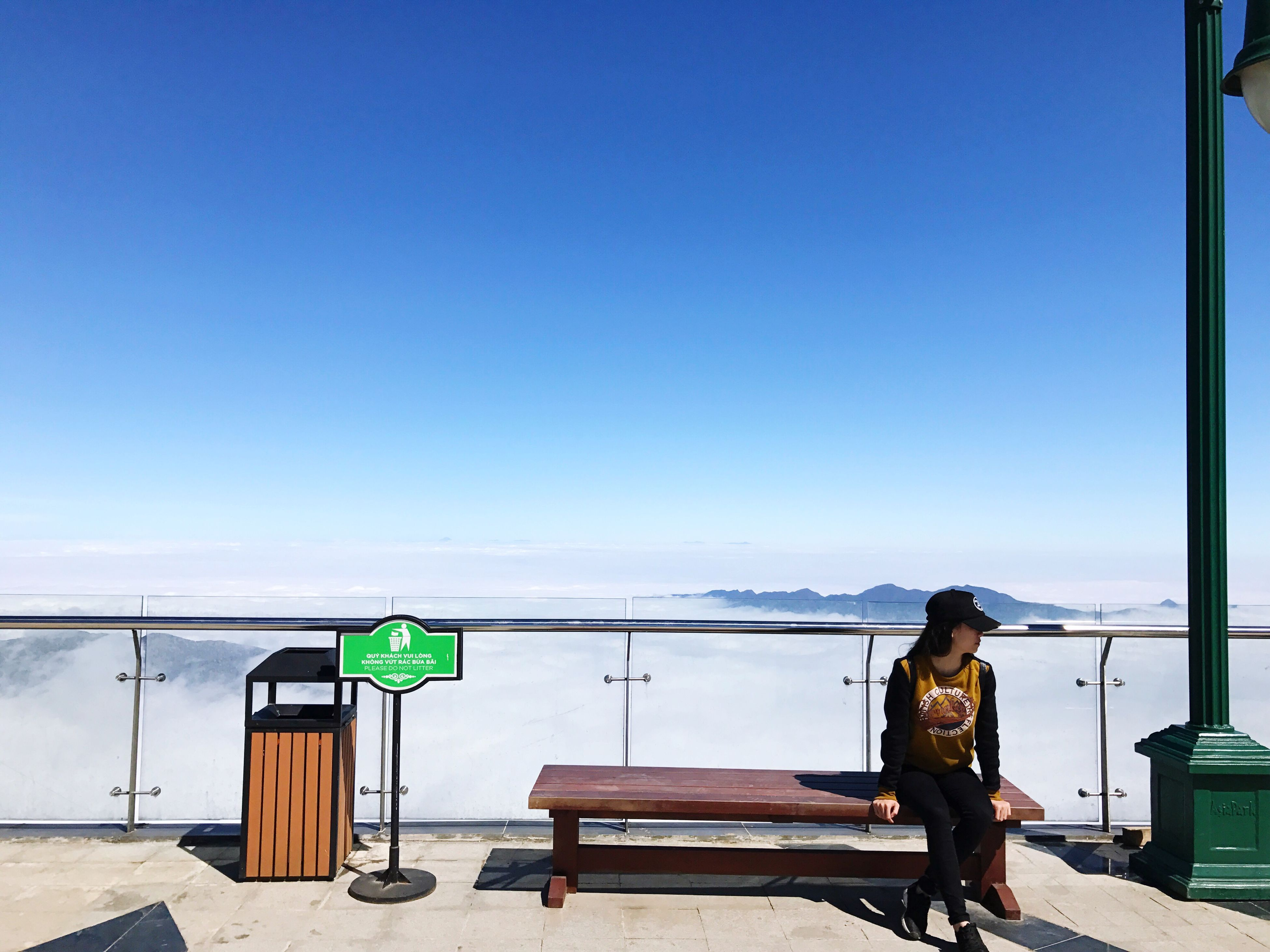 blue, clear sky, text, information sign, real people, communication, outdoors, sky, sea, day, one person, nature, people