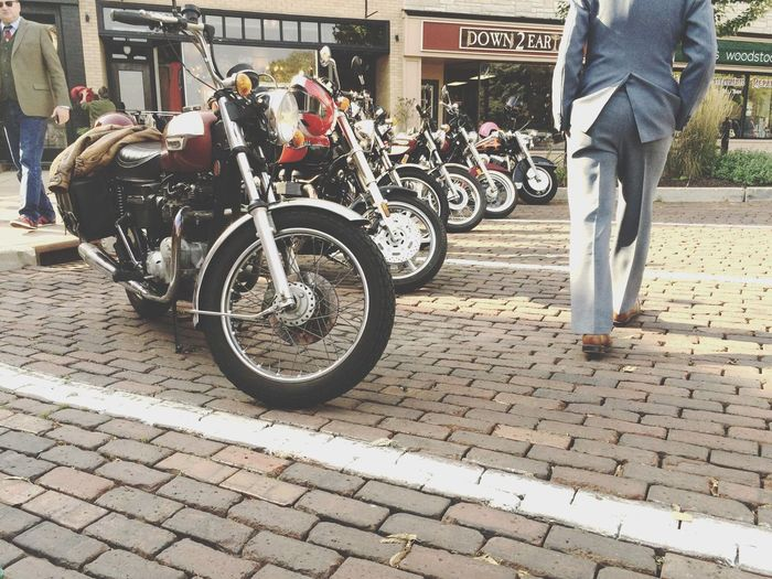 Transportation Mode Of Transport Street Cobblestone Men Walking Person Motorcycles Triumphmotorcycles Classic Classic Style People People And Places My Year My View Let's Go. Together. Connected By Travel