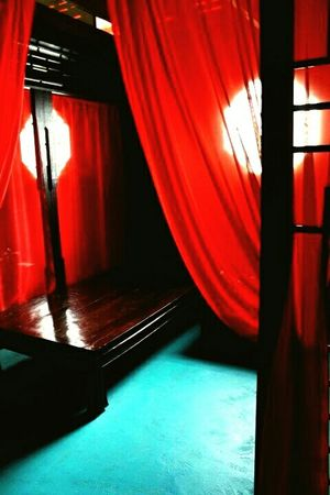 Red shade curtain tells something about this bed room.... Taking Photos RePicture Travel Hello World