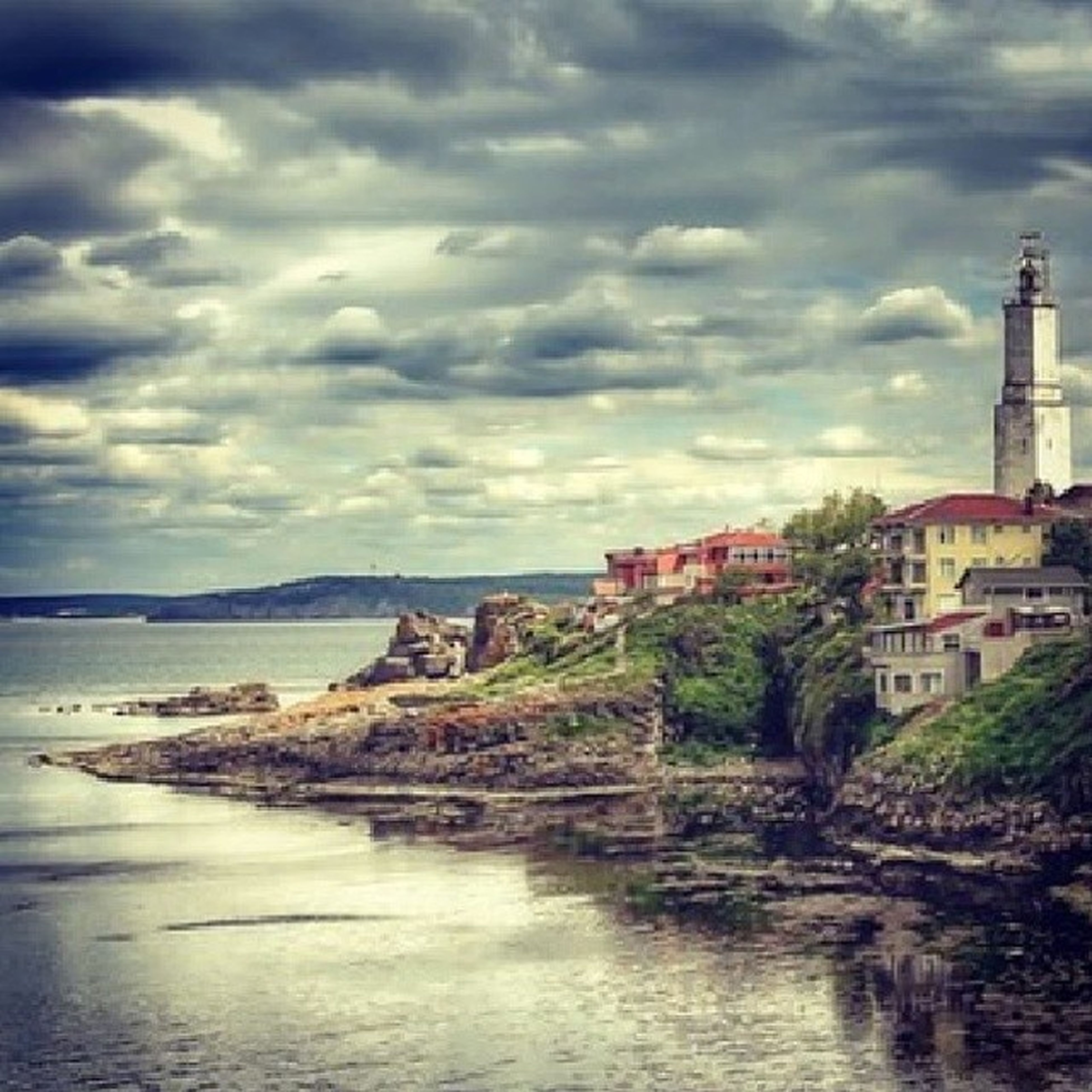 water, sky, building exterior, architecture, sea, built structure, cloud - sky, cloudy, cloud, waterfront, tranquil scene, scenics, overcast, tranquility, horizon over water, nature, house, beauty in nature, weather, coastline
