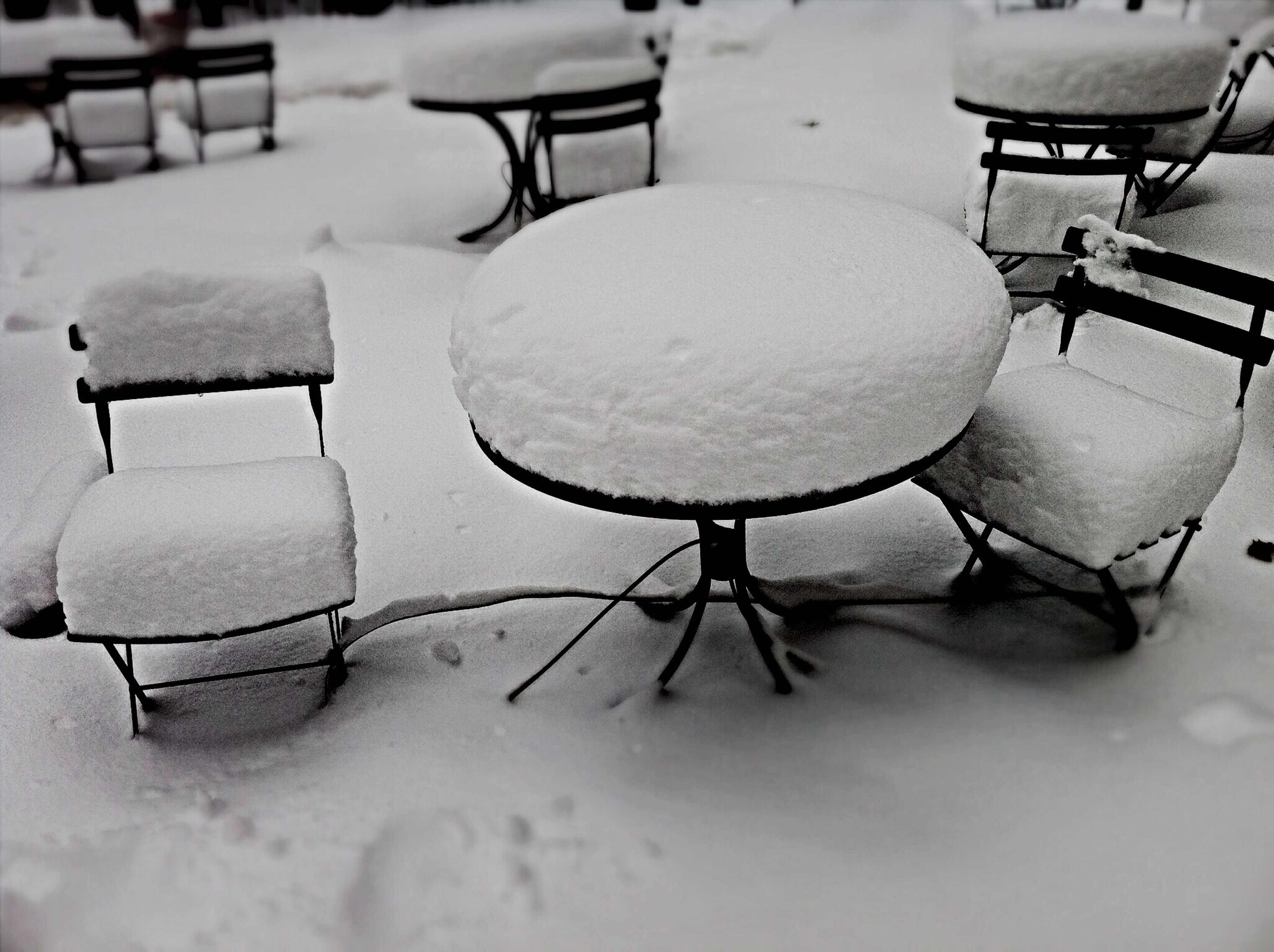 metal, chair, absence, empty, winter, snow, cold temperature, no people, close-up, still life, high angle view, covering, day, outdoors, seat, focus on foreground, abandoned, field, table, metallic