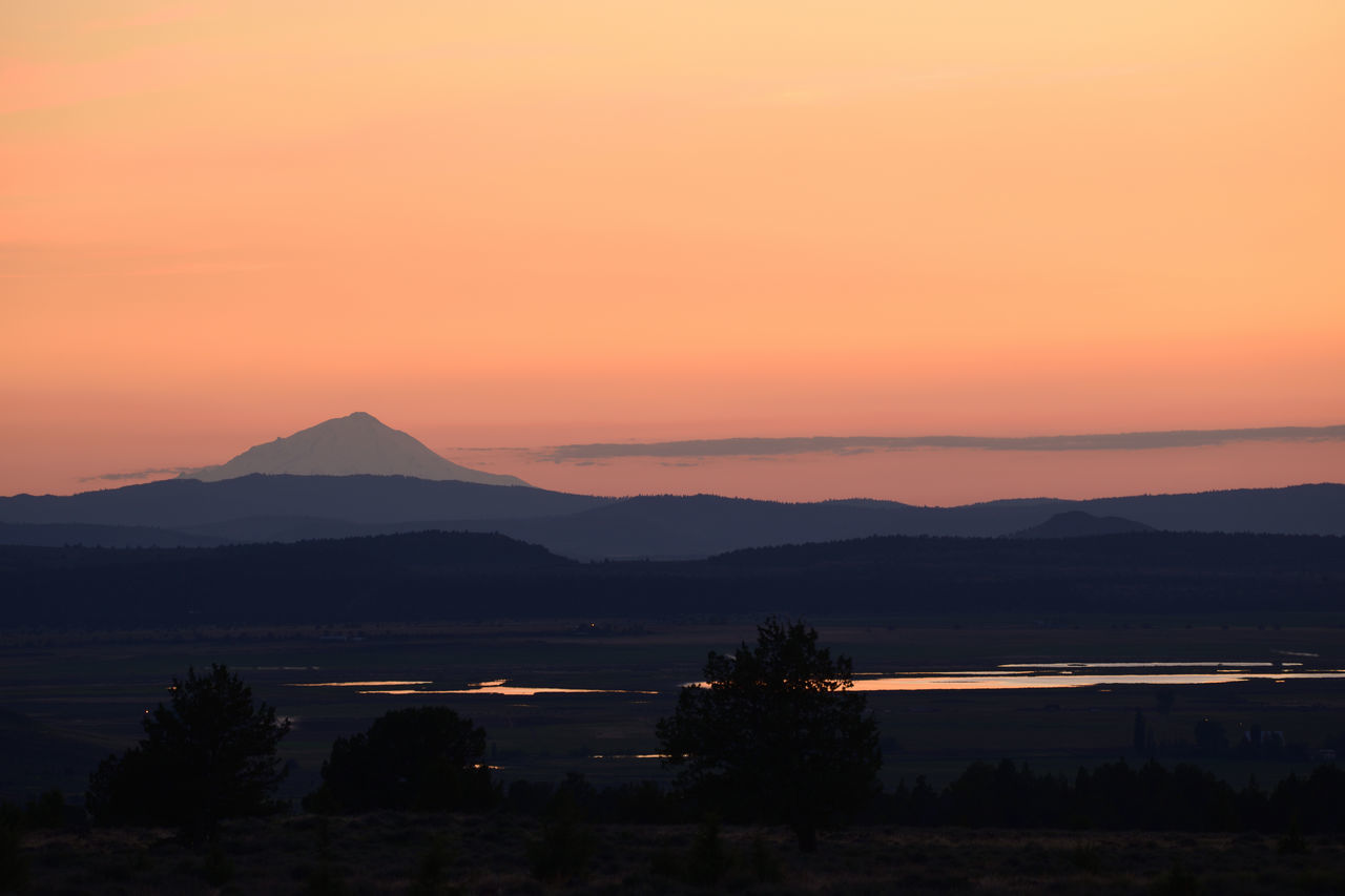 Mount Shasta silhouetted by orange sunset. Background Beautiful Beauty In Nature Black Space Environment Glow Lake Landscape Light Mountain Nature No People Orange Background Orange Color Outdoors Panorama Scene Silhoutte Sky Sunset Tranquil Scene Tranquility View Water Wild