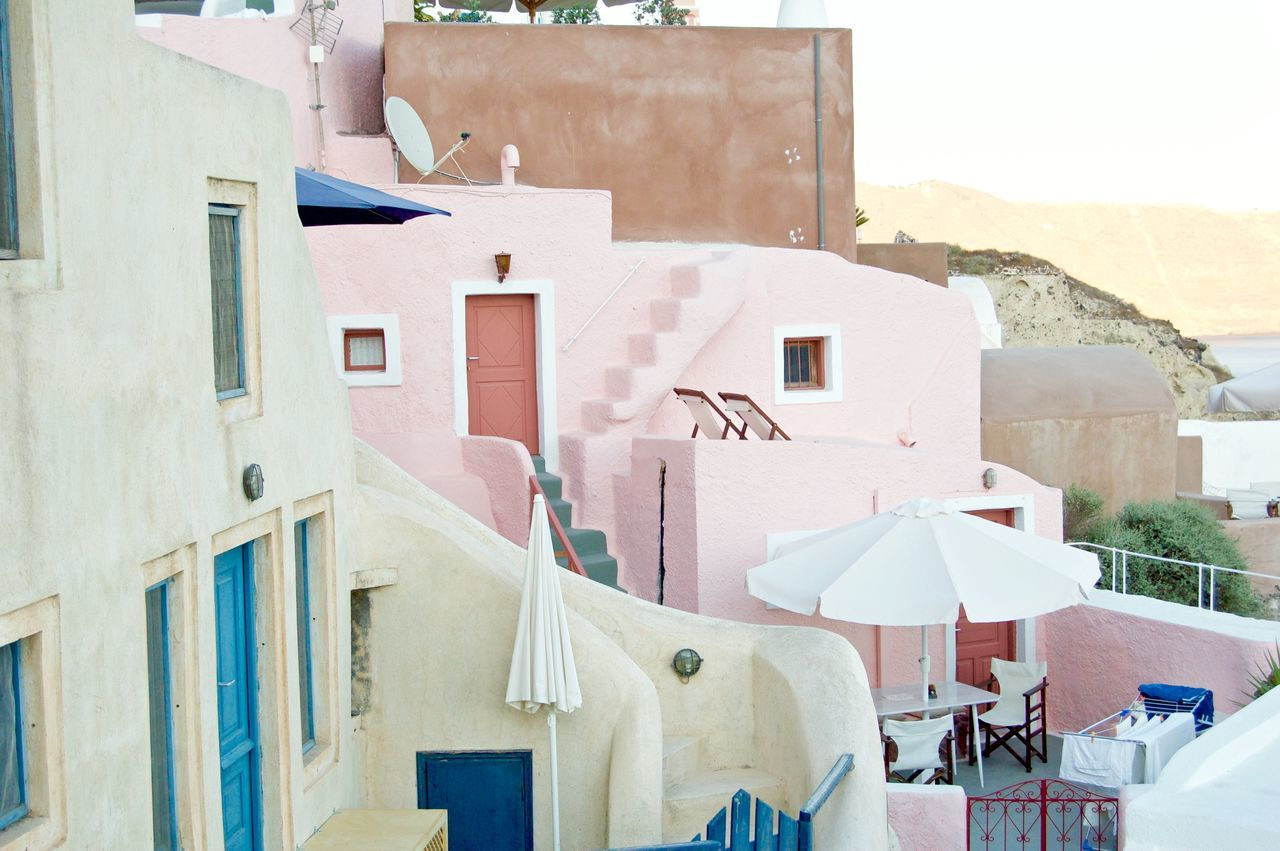 Architecture Building Exterior Built Structure Cave House Church Clear Sky Cross Day Greece House Low Angle View No People Outdoors Pink House Place Of Worship Religion Residential Building Residential Structure Roof Santorini Santorini, Greece Spirituality Sunlight