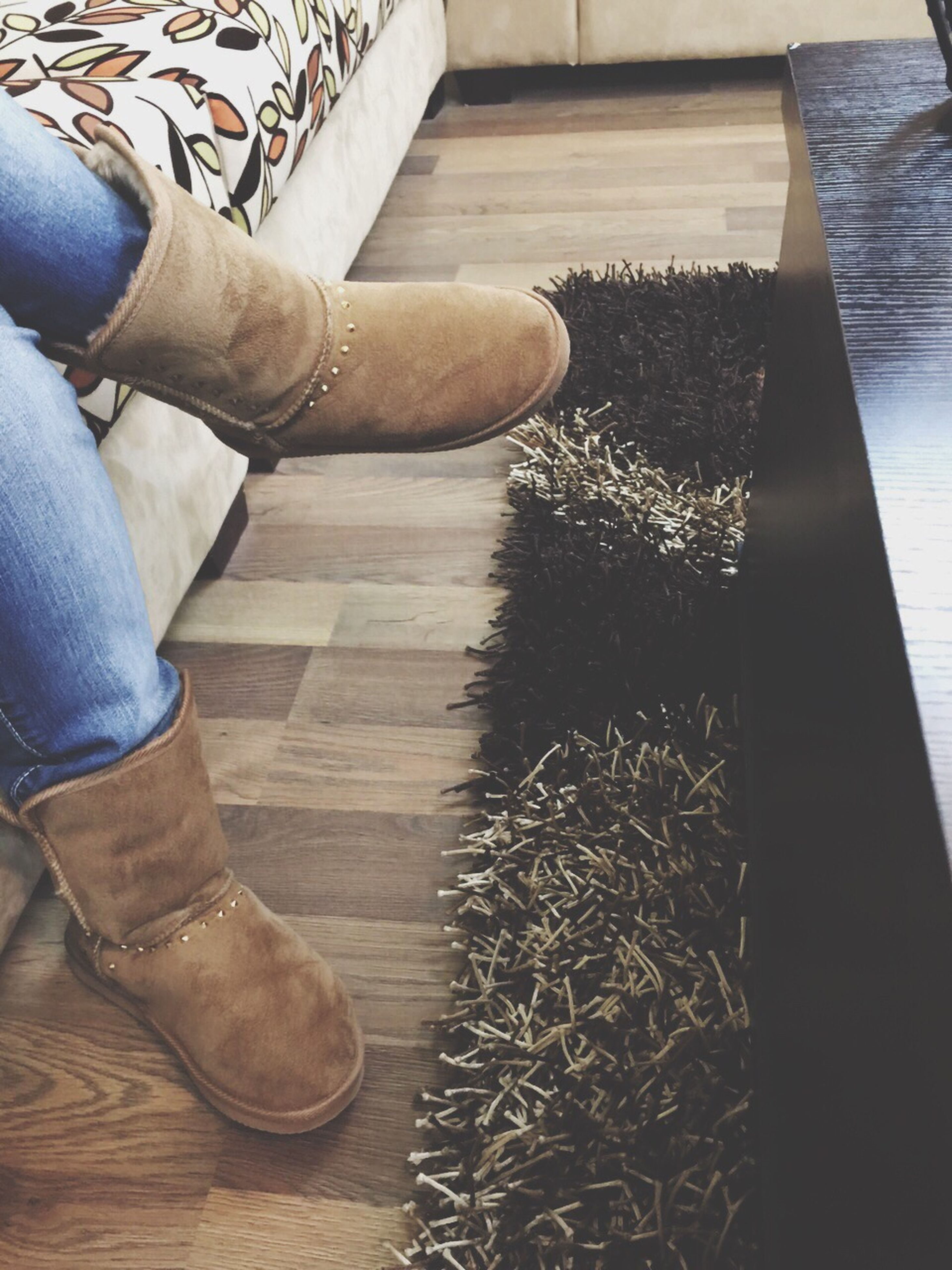 low section, person, shoe, human foot, lifestyles, part of, high angle view, indoors, personal perspective, footwear, standing, wood - material, leisure activity, unrecognizable person, men, flooring