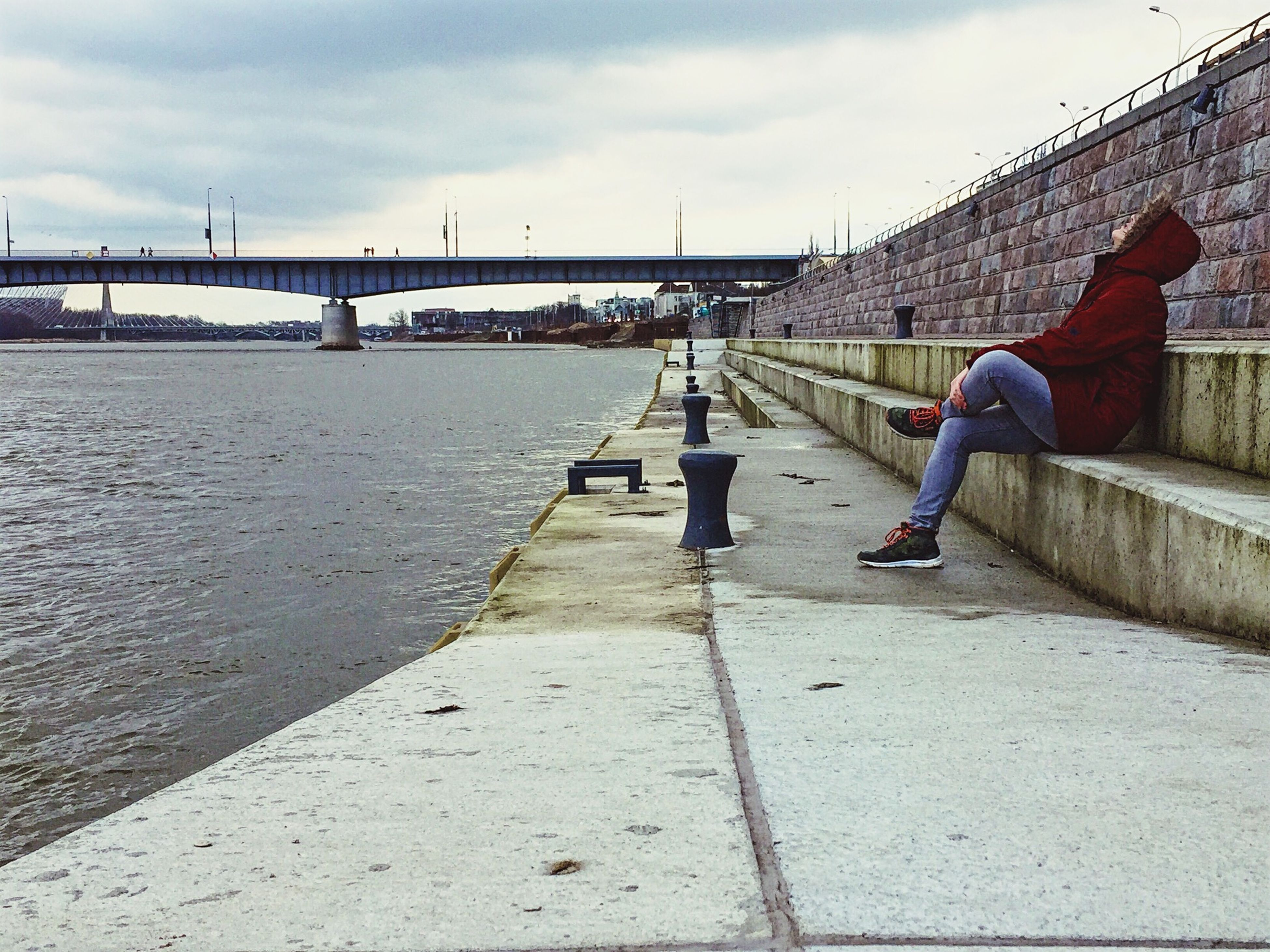 lifestyles, leisure activity, men, sky, full length, rear view, built structure, water, architecture, person, walking, cloud - sky, bridge - man made structure, casual clothing, standing, railing, connection