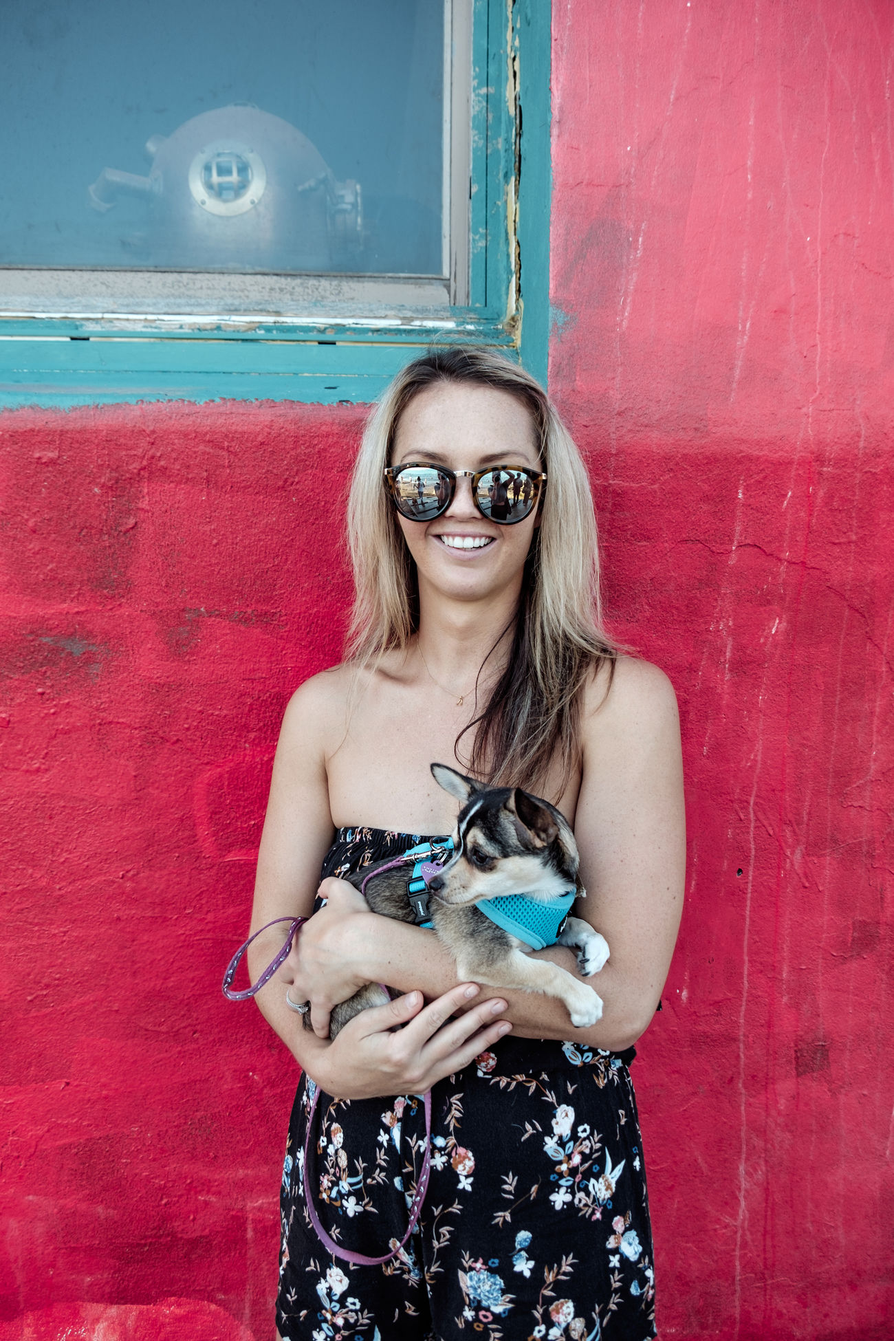 Adult Adults Only Beautiful Woman Day Dog Flavored Ice Fun Happiness Leisure Activity Long Hair One Person One Woman Only One Young Woman Only Only Women Outdoors People Pink Color Portrait Puppy Real People Smiling Sunglasses Turquoise Young Adult Young Women