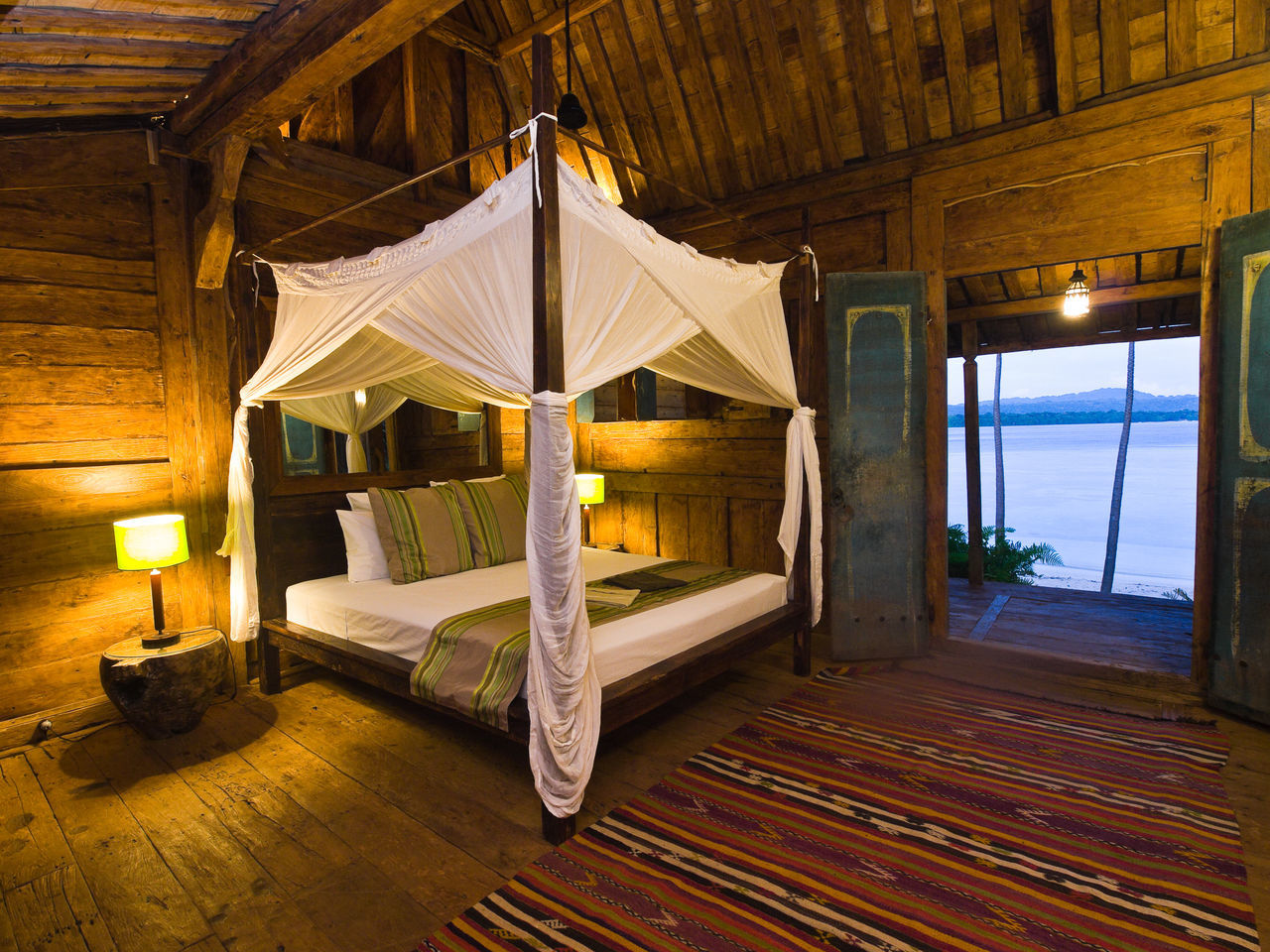 Tropical Beach Getaway Ratau Private Island Espiritu Santo Vanuatu. Architecture Bedroom Building Exterior Built Structure Bungalow On The Beach Espiritu Santo Vanuatu. Illuminated Lit Luxury No People Paradise Beach Suite Tropical Beaches
