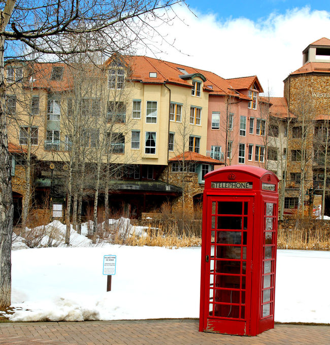 Architecture Building Building Exterior Built Structure Colors Exterior No People Outdoors Red Red Red Telephone Boo Sky Snow Sunlight Telephone Booth Tell Tree Window