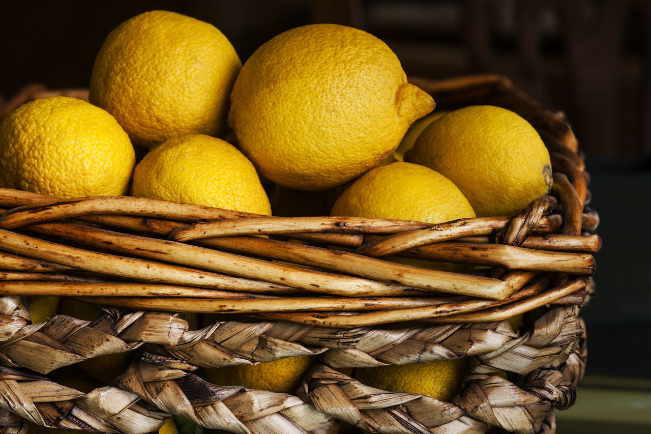 Close-Up Of Lemons In Wicker Basket