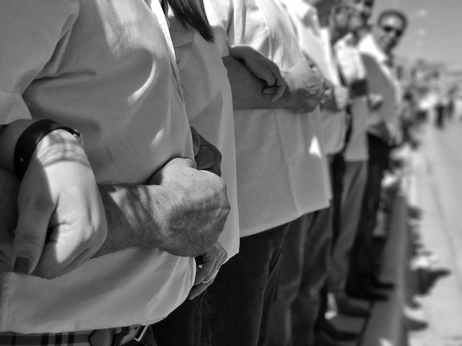 Linking arms at a bipartisan Rally At The Border. Border Life Del Rio Tx Radney Foster No Wall Protest The Resistance Real People Blackandwhite Photography Black And White Photography Human Hand Men Resist Black&white Resist