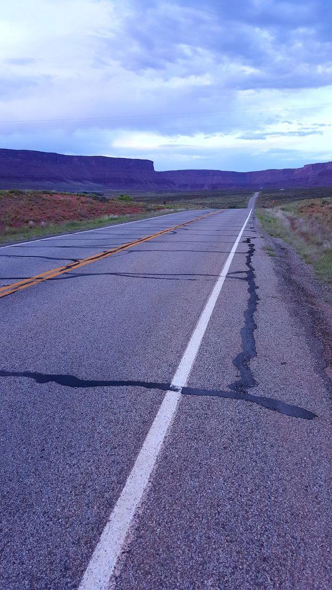 Open Road Scenic View Scenic Drive Arid Landscape Vast Red Rocks  Utah