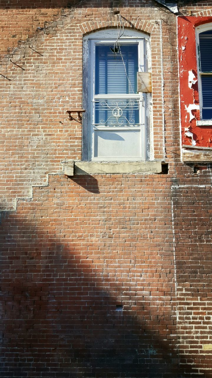 brick wall, building exterior, window, architecture, built structure, outdoors, no people, day, red