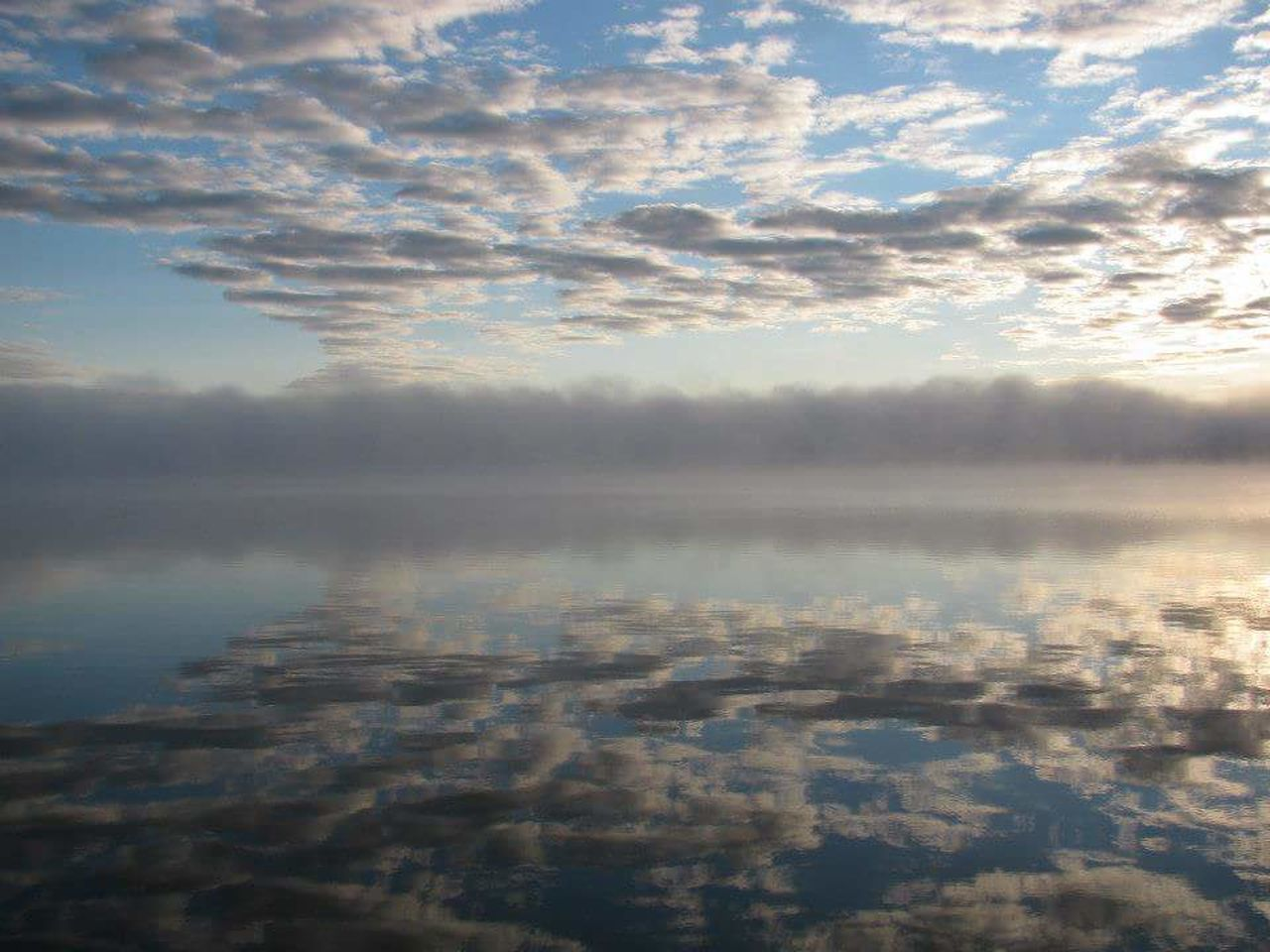 sky, tranquility, tranquil scene, reflection, cloud - sky, nature, scenics, beauty in nature, no people, outdoors, day, water