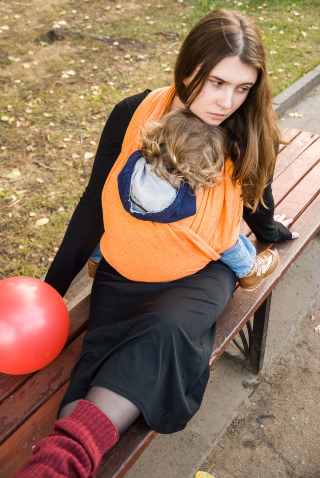 The holiday is over... Baby Baby Wrap Babywearing Balloon Bonding Childhood Children Contemplating Day Family Lifestyle Love Maternity Mom Mother And Son Motherhood Outdoors Parenting Perspective Portrait Real People Sitting Sleeping Sling Woman