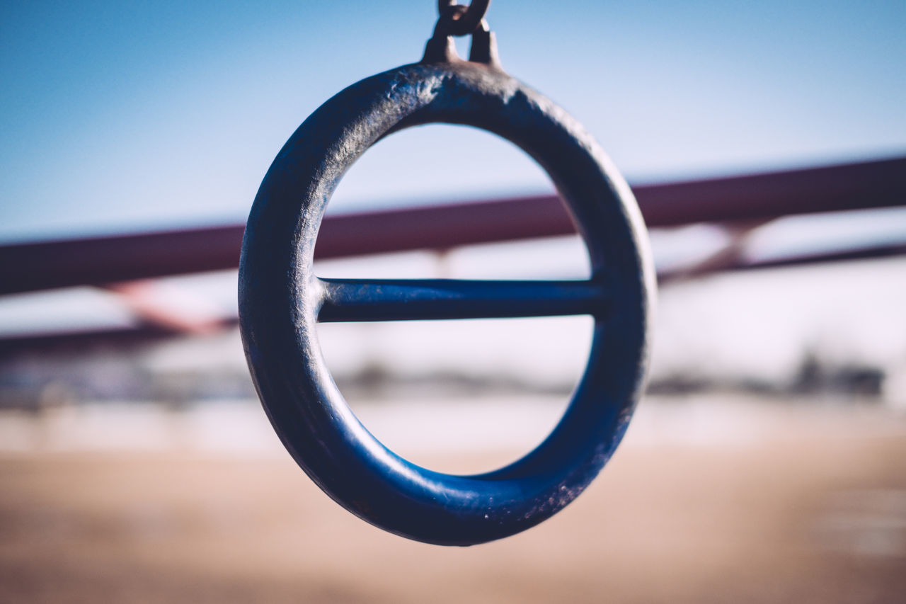 Blue Close-up Day Focus On Foreground Metal Monkey Bars No People Outdoors Playground Playground Equipment Ring