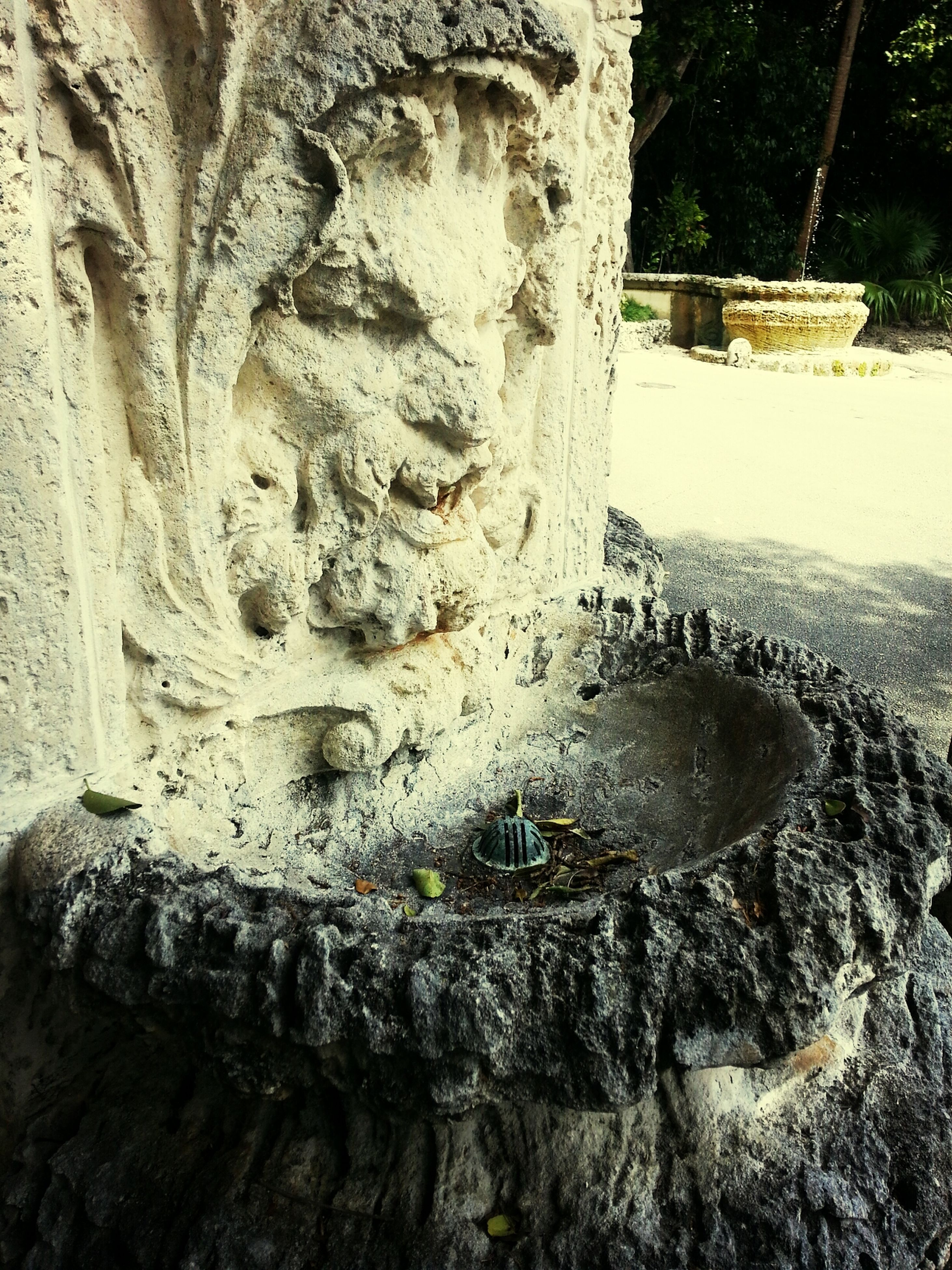art and craft, art, human representation, creativity, sculpture, statue, old, carving - craft product, weathered, stone material, built structure, close-up, history, the past, architecture, tree, cemetery, religion, wall - building feature