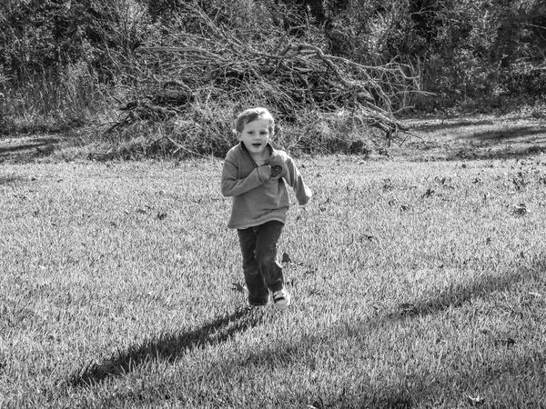 Day One Person Shadow Real People Outdoors People Boy Running Playing Running Shadow People Monochrome Black And White Photography Happiness Smiling Face Action Shot  Motion People In Motion People In Action Stopped In Motion Running Towards Black And White Childhood Child Child Playing Playing Chase Black And White Friday EyeEm Ready