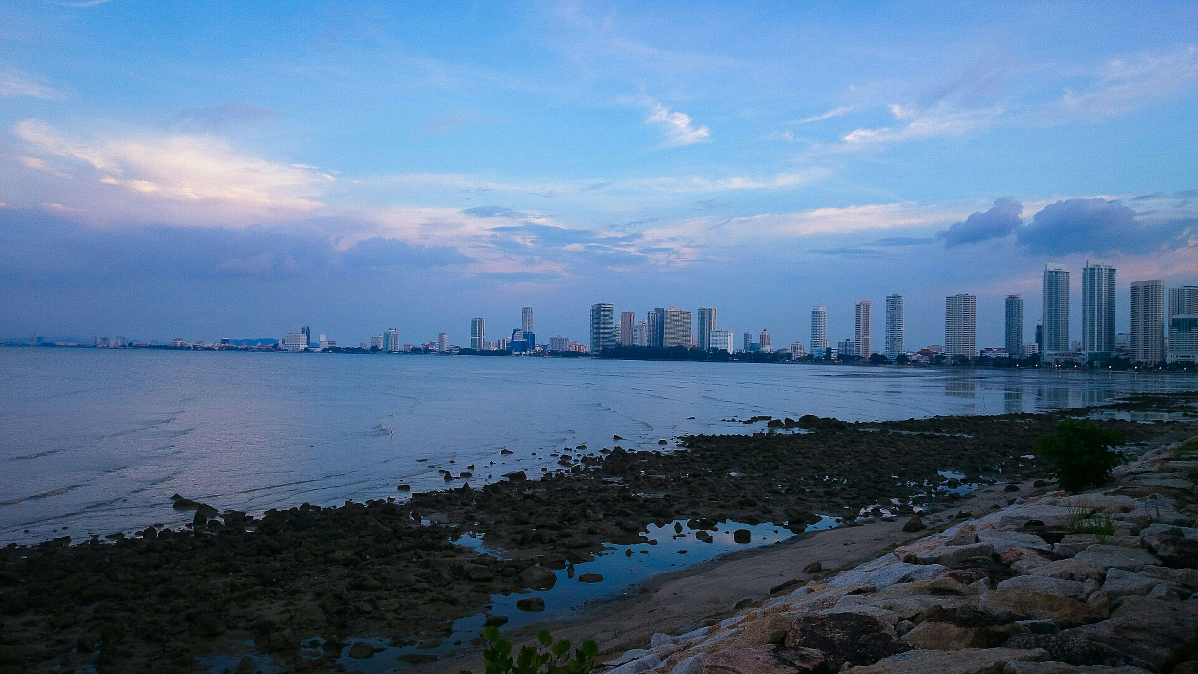 building exterior, water, architecture, built structure, city, sky, sea, cityscape, cloud - sky, urban skyline, skyscraper, river, beach, high angle view, nature, tower, residential district, shore, outdoors, blue