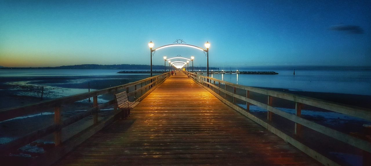 Sea Water The Way Forward Horizon Over Water Pier Railing Clear Sky Long Tranquil Scene Narrow Scenics Illuminated Boardwalk Calm Walkway Jetty Architecture Nature Bridge Day Outdoors Bridge - Man Made Structure Fragility Freshness Non-urban Scene