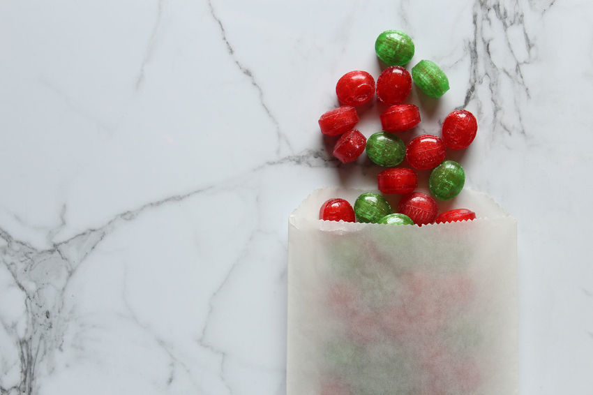 Treats Candy Store Celebration Christmas Copy Space December Green Holiday Red Sugar Above Backgrounds Candy Counter Delicious Festive Food Frame Indulgence Marble Season  Spill Sweets Table Treat Bag