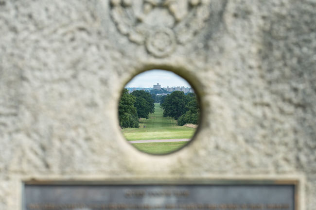 Windsor castle through the millstone memorial Castle Circle Geometric Shape Hole No People Queen Annes Ride Selective Focus Windsor Castle Windsor Great Park