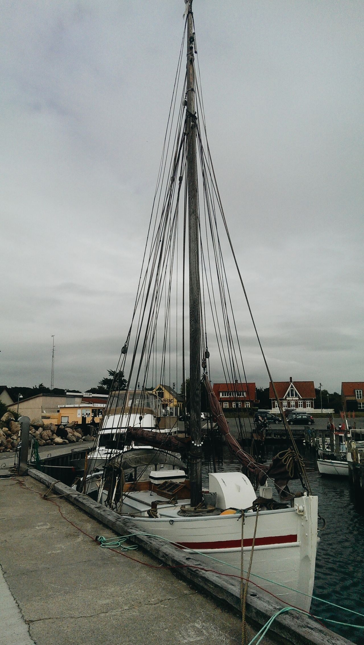 Taken with my HTC One M7 - 2015 Denmark Sailing Ship Tall Ship Nautical Vessel Harbor Sailboat Fishing Port Sea Water Sky Mast Maritime Yachting CloudyBridge - Man Made Structure Langeland Denmark Outdoors Transportation Sailing Yacht Suspension Bridge Travel Destinations Built Structure Day No People