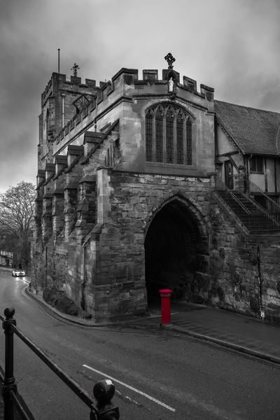 Arch Arched Architecture Building Exterior Built Structure Churches Culture Entrance Gate Historic History Low Angle View Old Ornate Religion Stone Wall Warwick