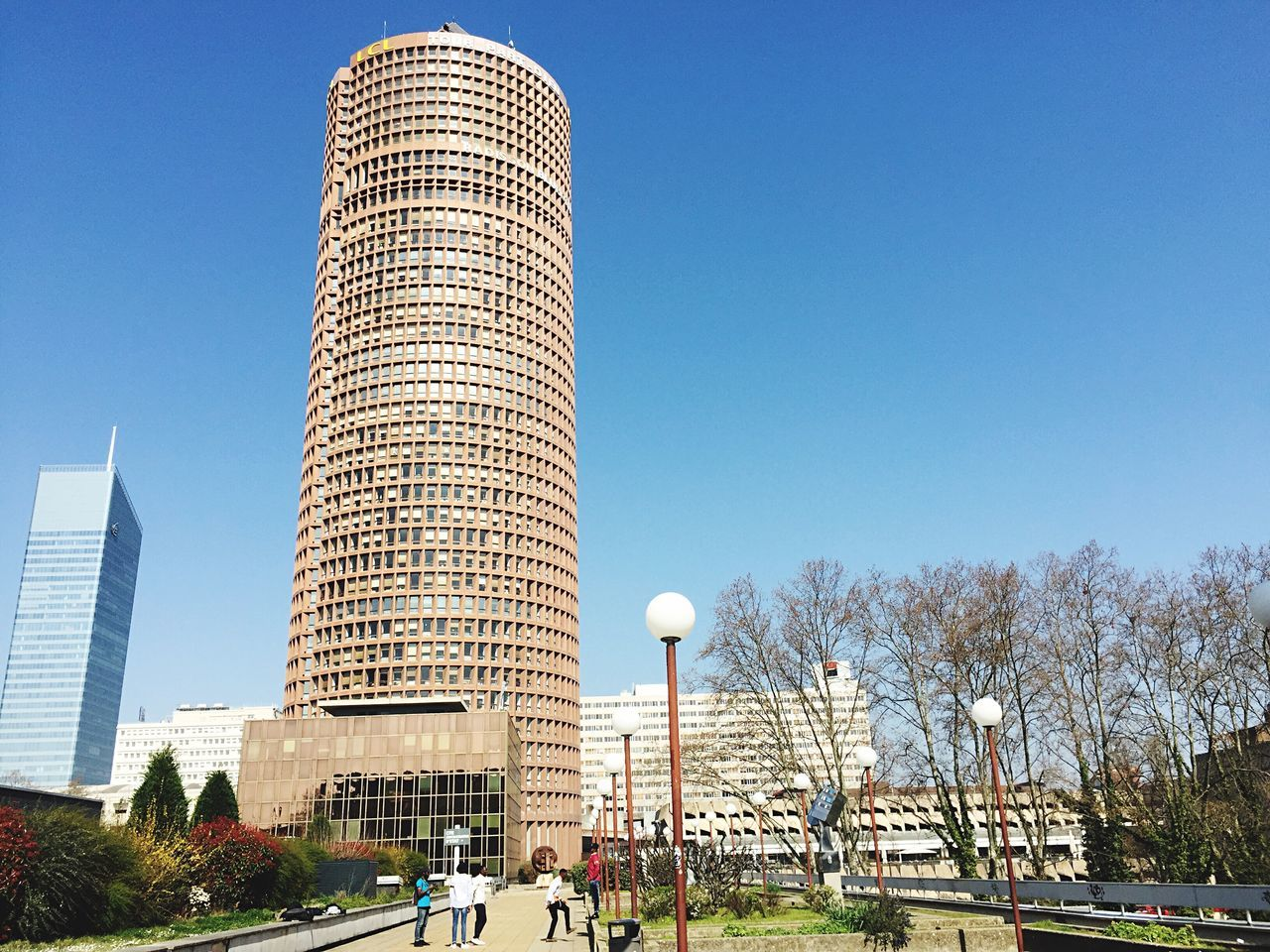 architecture, built structure, skyscraper, tall - high, building exterior, clear sky, tower, city, travel destinations, day, tree, outdoors, modern, no people, sky