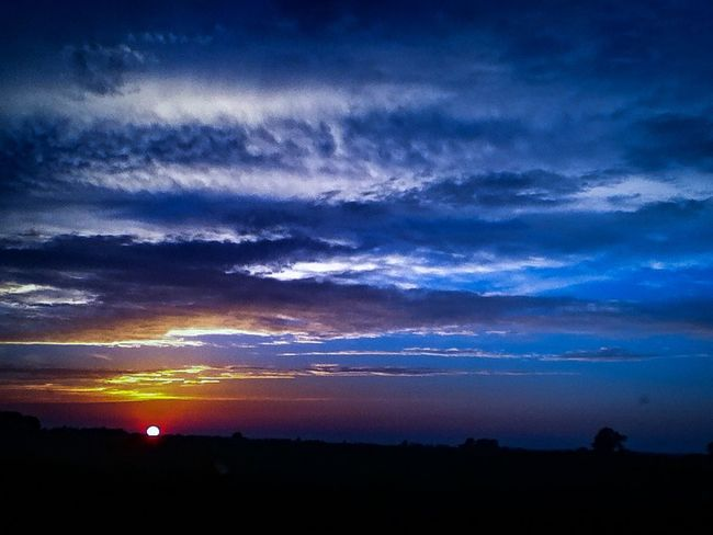 Beauty In Nature Blue Calm Dramatic Sky Landscape Majestic Moody Sky Nature No People Non-urban Scene Outdoors Outline Remote Silhouette Sunset Tranquil Scene