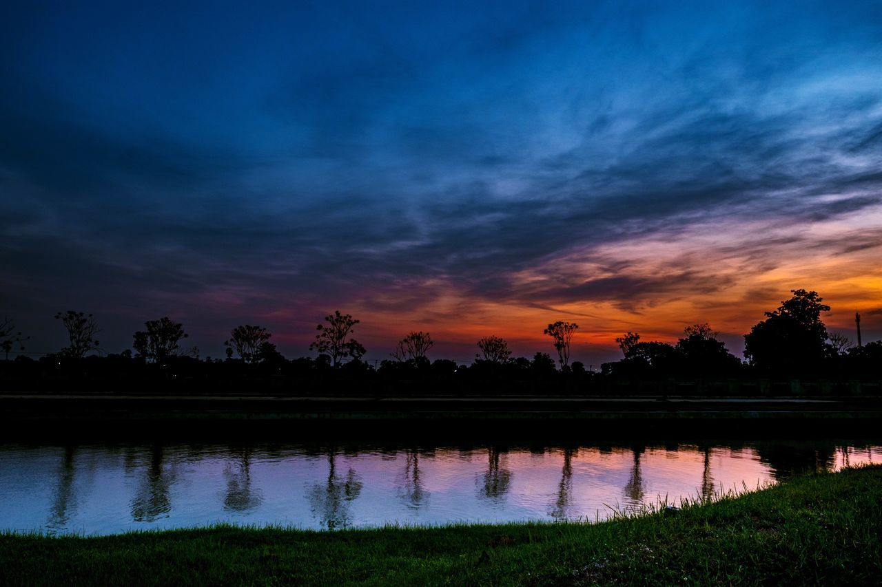 sunset, reflection, nature, scenics, beauty in nature, tree, orange color, tranquil scene, silhouette, lake, sky, tranquility, water, no people, cloud - sky, outdoors, landscape, grass, rice paddy, day