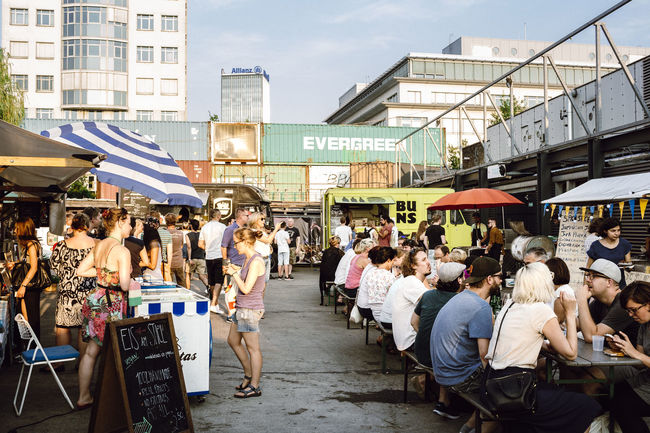 The best street food market = Bite Club Berlin Street Markets Building Exterior City City Life Food Food And Drink Full Length Leisure Activity Lifestyles Market Occupation People Real People Rear View Street Street Photography Streetfood Umbrella Urban Walking Women
