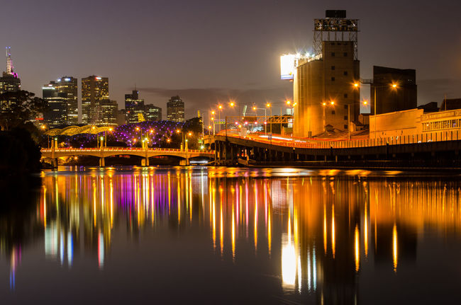 Nighttime view of the Nylex building in Melbourne Australia Architecture Bridge City City Life Cityscape Horizontal Symmetry Illuminated Long Exposure Melbourne Motion Night Nylex Reflection River Water Waterfront