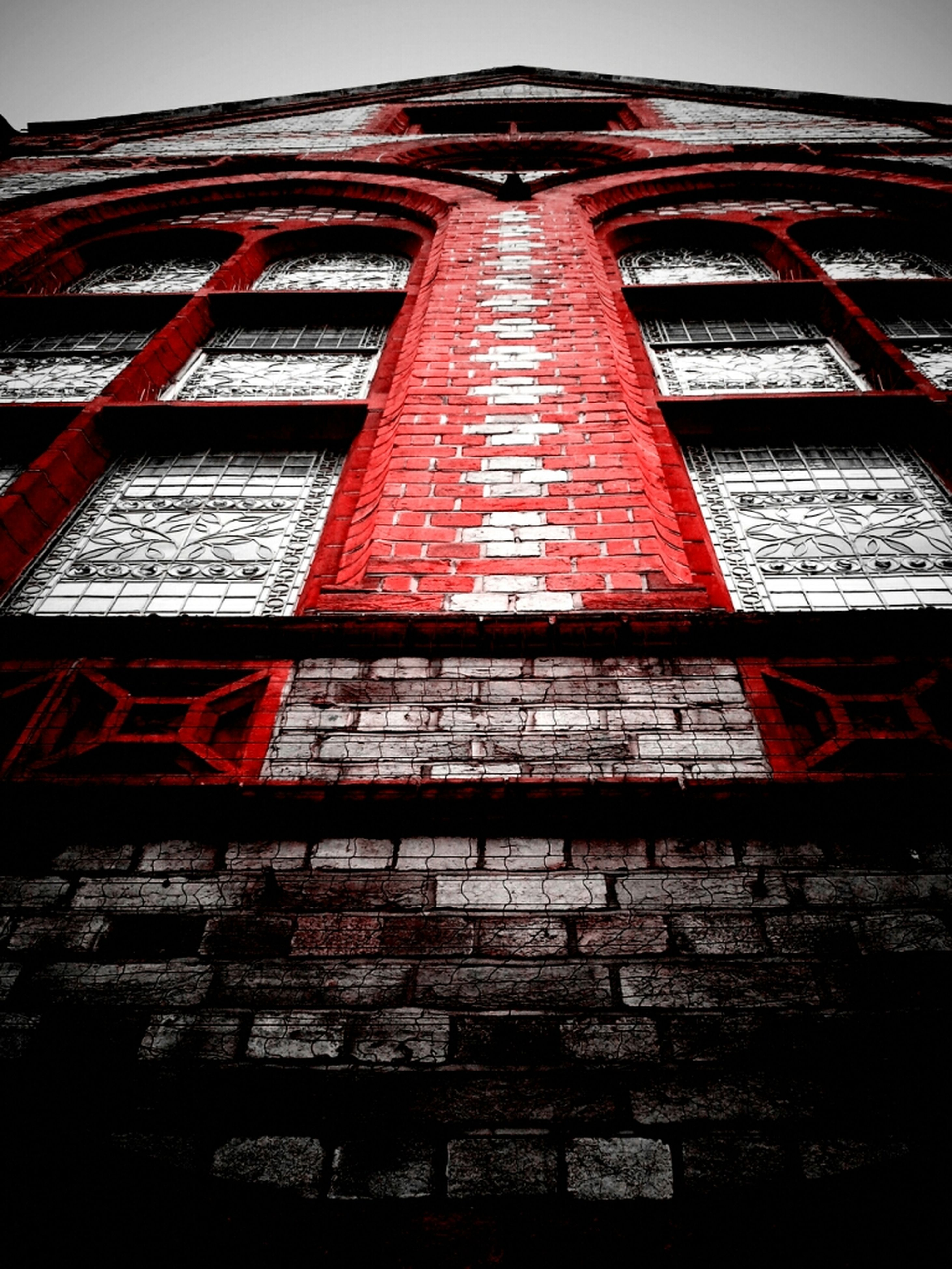 architecture, building exterior, built structure, low angle view, red, window, brick wall, building, clear sky, exterior, day, outdoors, residential structure, house, no people, sky, old, residential building, brick, facade