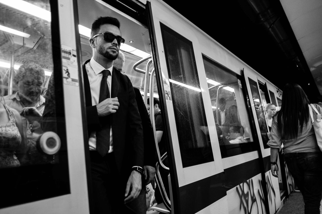 Monochrome Photography men in black, by Claudia Ioan Transportation Travel Black And White Public Transportation Men Person Subway Train Suit Commuter Indoors  Urban Exploration Street Photography Streetphoto_bw Fujifilm People Horizontal Embrace Urban Life