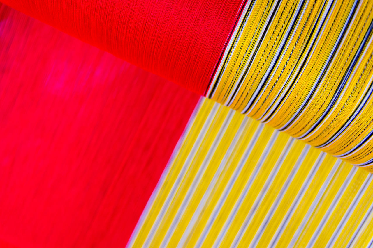 backgrounds, striped, pattern, red, indoors, close-up, multi colored, yellow, textured, no people, paper, freshness, day
