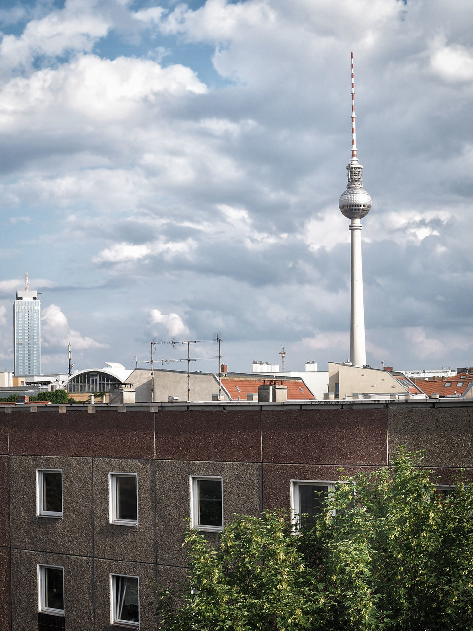 View Of Communications Tower In City Against Sky
