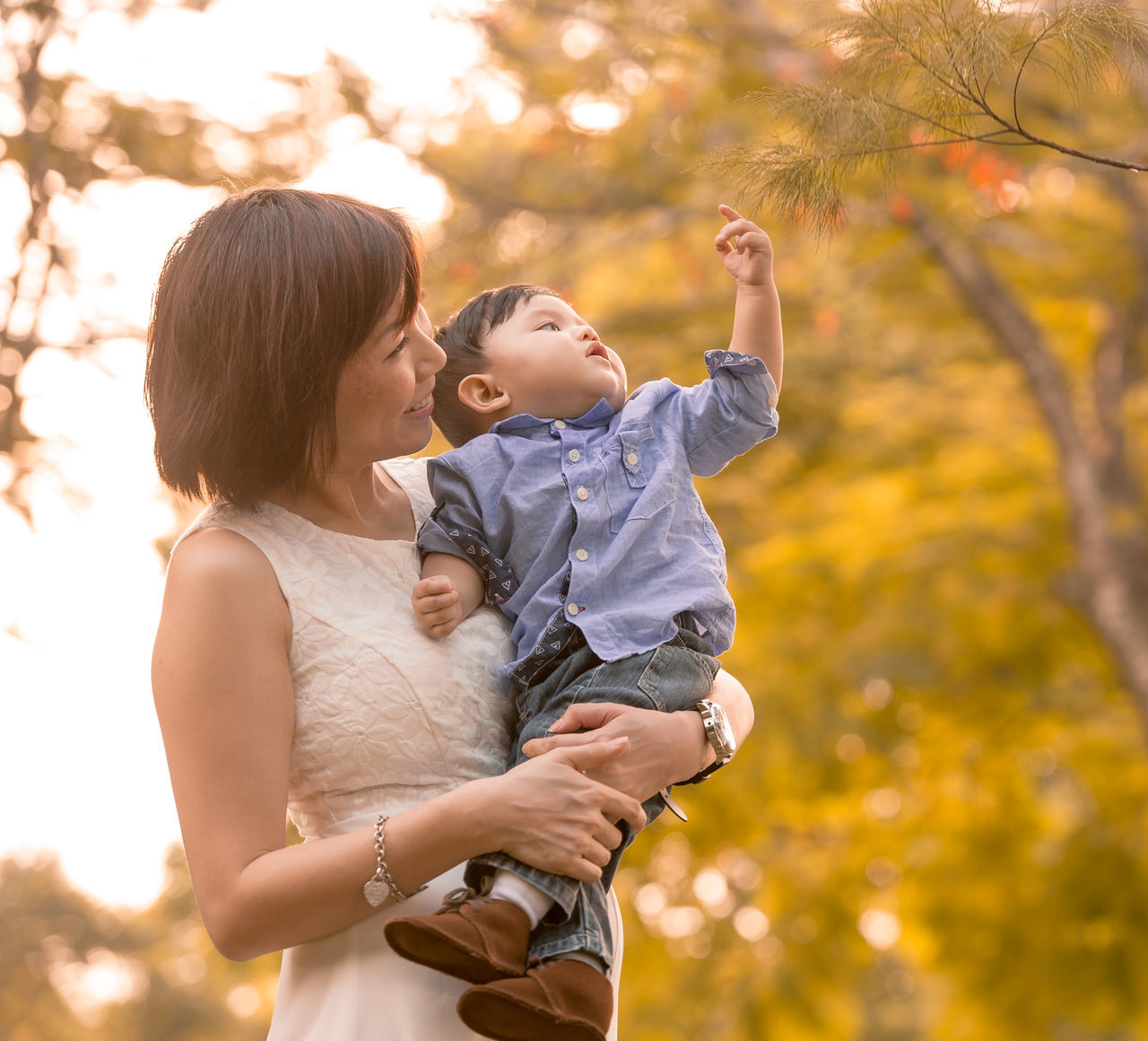 Chinese Family ASIA Asian  Asian Family Baby Bonding Casual Clothing Childhood Chinese Daughter Day Family Family With One Child Focus On Foreground Happiness Leisure Activity Lifestyles Love Mother Outdoors Real People Smiling Son Togetherness Tree Young Women