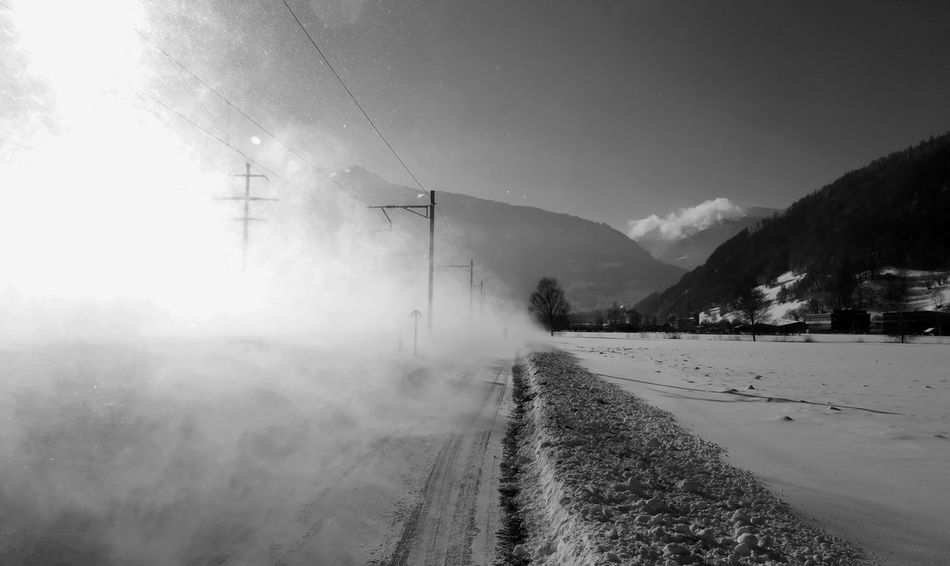 Fast train! After The Train Against The Sun Blackandwhite Photography Contrast Fast Train Landscape Olympus OM-D E-M1 Mark II Outdoors Passed By Railroad Photography Railway Sargans Sarganserland Schneegestöber Schneewirbel Snow Snow Blasted Snow Flurries The Way Forward Train Tracks Trains Trainspotting Trapped Winter Sun