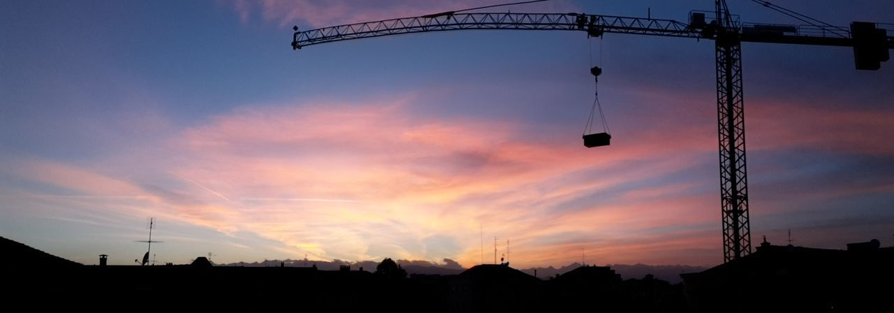 Panoramic Photography flexible crane! Crane Sunset Panorama Cityscape Rooftops Silhouette Pink Sky From The Balcony Cranes And Construction Mountains And Sky BYOPaper! The Great Outdoors - 2017 EyeEm Awards Colour Your Horizn